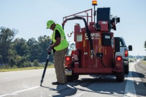 Crafco equipment applying Crafco sealant on road