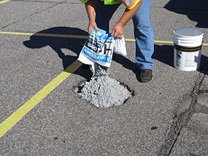 Crafco HP Concrete Cold Patch parking lot installation