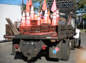 Domino's Paving for Pizza orange cones on truck